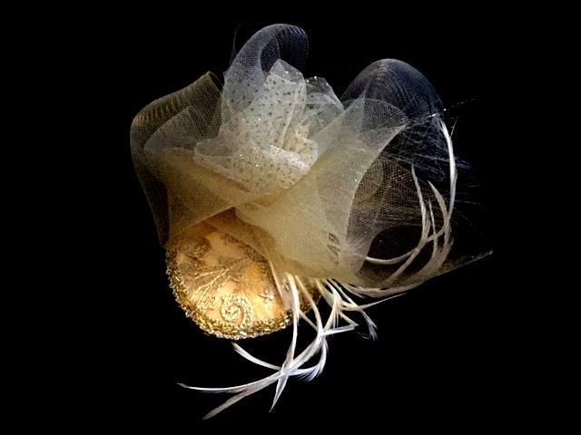 Gold bridal hat made out of crin
